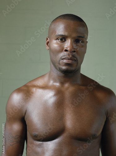 Bare-chested boxer, portrait