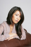 Pretty asian american woman with thoughtful expression poster