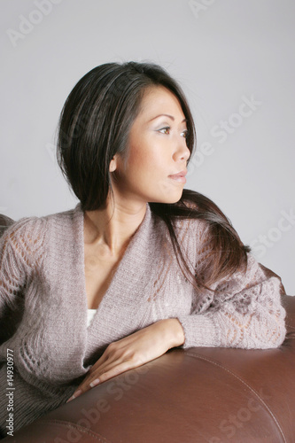 Lovely woman looking to her left thoughtfully