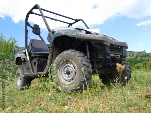 Moto all-terrain vehicle in mountains