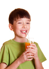 Smiling boy with a glass of juice