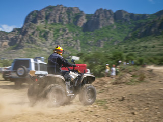 Enduro competition - off-road atv crossing rider