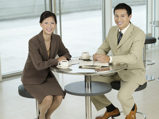 Business colleagues Sitting at table, portrait