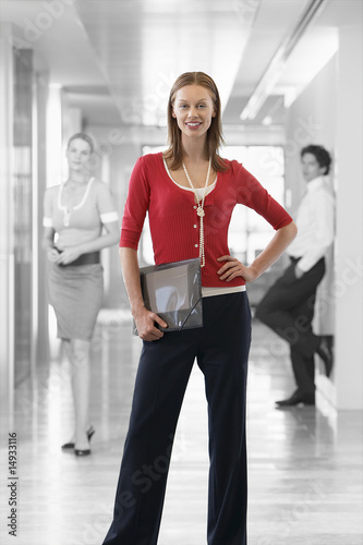 Businesswoman with Businesspeople in Background