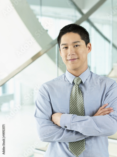 Confident Businessman standing, arms crossed