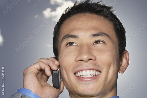 Smiling Businessman Using Cell Phone, close-up