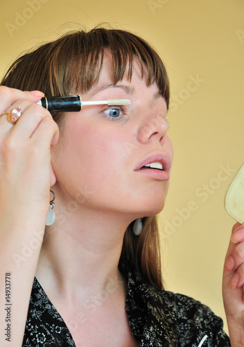 applying make up - white mascara