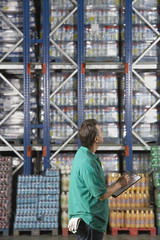 Warehouse Worker Checking Inventory, side view
