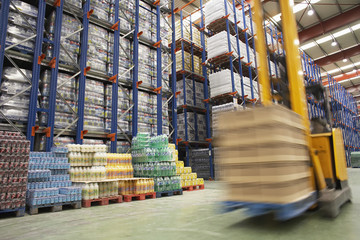 Speeding Forklift in Warehouse