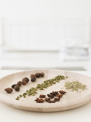 Variety of spices on wooden serving platter