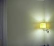 Sconce Shining Light onto Corner in Room
