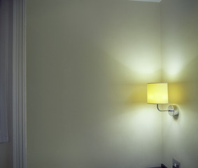 Sconce Shining Light onto Corner in Room