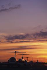 Planes Sitting on Tarmac at Sunset