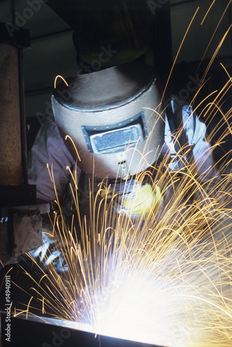 Welder wearing protective face mask welding at Work