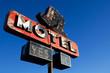 retro motel sign blue sky