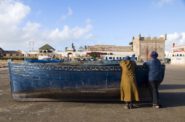 african men on fishing boat essaouira morocco