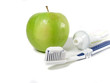 Green apple, toothbrush and toothpaste