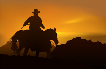 Cowboy over sunset