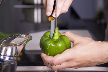 Washing a green pepper