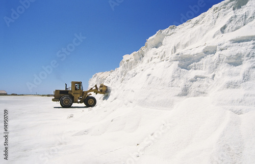 Digger truck advancing into wall of snow