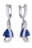 Earrings with zircon and expensive big gemstones poster