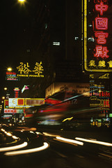 China, Shanghai, illuminated street at night
