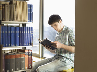 College Student Reading in Library