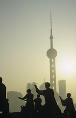 China, Shanghai, silhouettes of people against city skyline Oriental Pearl TV Tower