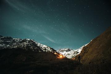 Fire in rugged mountainous landscape