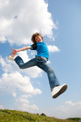 Happy jumping boy. Soft focus. Focus on eyes