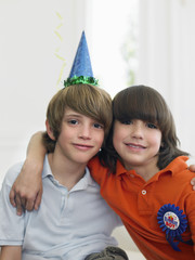 Portrait of two boys 10-12 at birthday party