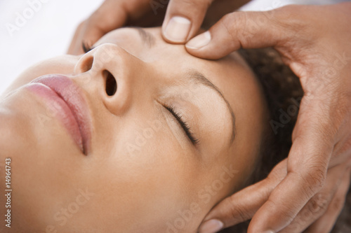 Woman receiving massage, close-up of face