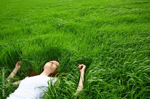 Leinwandbild Motiv beautiful girl lying down of grass