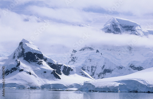 Antarctica, Snow covered mountains and icebergs
