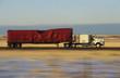 Truck on road in desert