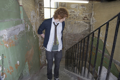 Young man in old dilapidated building