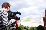 Cameraman filming poster