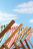 Row of deck chairs on beach