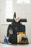 Backpack and camping equipment in hallway