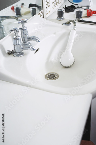 Shower head in sink at barber shop