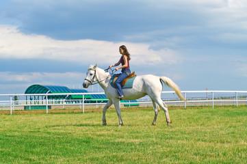 the girl astride a horse