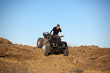 teen on ATV quad in the hills