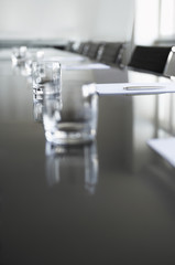 Empty glasses on conference room table
