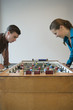 Young man and woman playing table football in game room