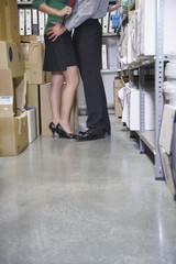 Couple embracing in office storage room