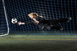 Goalie wearing business suit, woman