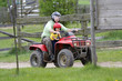 Dad with son riding a quad
