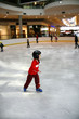 Young boy learning to skate