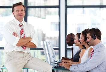 Senior manager with crossed arms in a call center