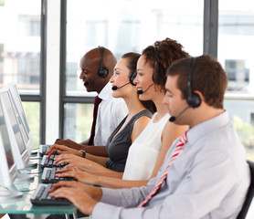 Attractive African-American businessman in a call center